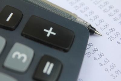 Calculator, pen and receipts
