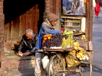 Nepalese man selling grapes