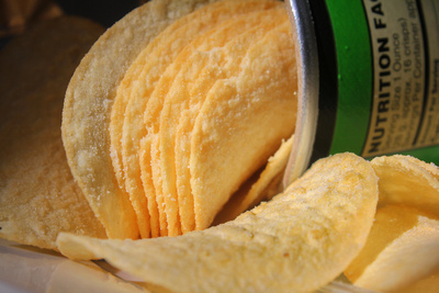 Opened can of Pringle potato chips