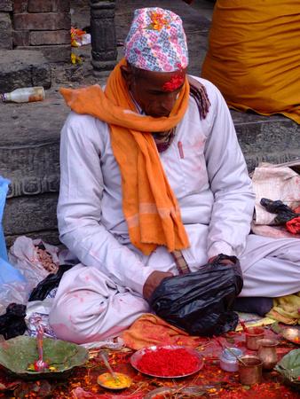 Nepalese man giving tikka blessings at Shivaratri