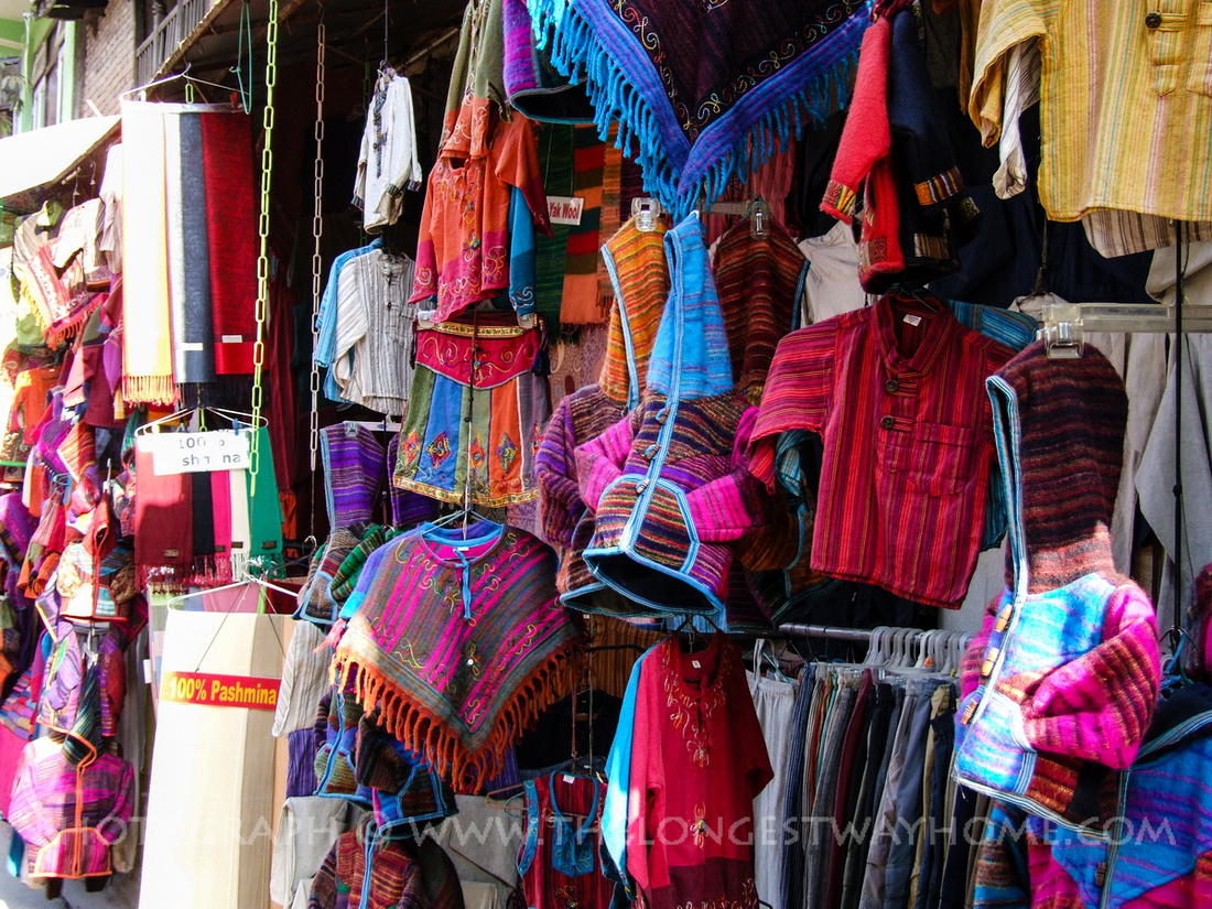 Traditional clothes hanging from a shop in Nepal