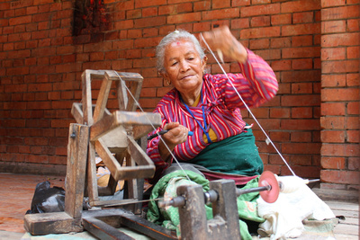 Lady spinning yarn in Nepal