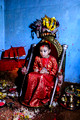 Kumari on a throne