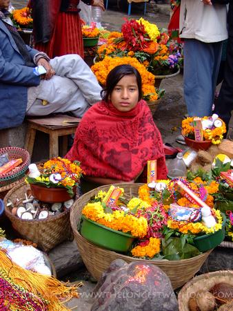 Girl selling flowers in Nepal
