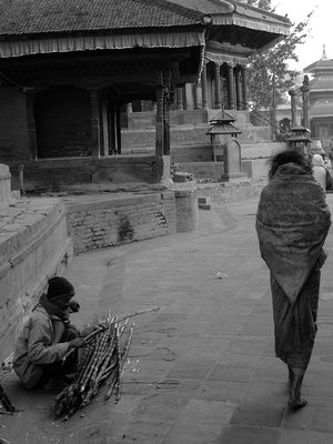 A beggar walks to work on the streets of Kathmandu