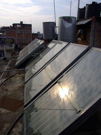 Solar panels in Nepal reflecting sunlight