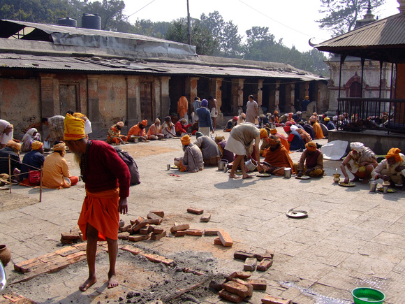 Sadhus in an inner courtyard having lunch