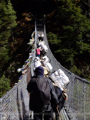 Crossing a suspension bridge in Nepal