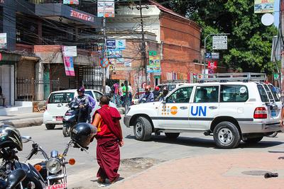 UN car with monk in Kathmandu