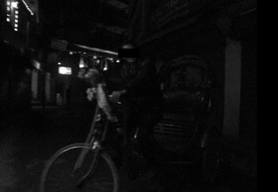 Rickshaw driver at night