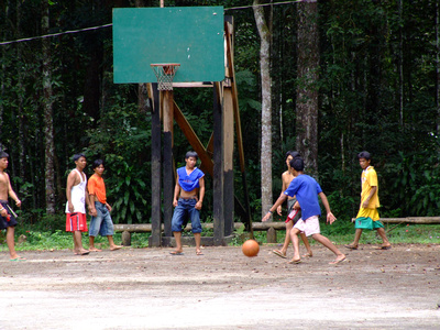 Locals playing basketball in The Philippines