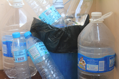 Empty water bottles in a hotel bin
