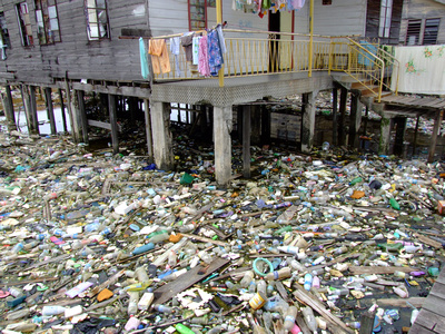 Garbage floating in water around slum in Malaysia