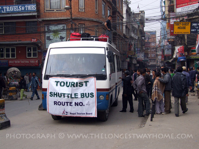 Tourist buses take travelers to the airport during strikes