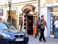 Polish business car beside tourist
