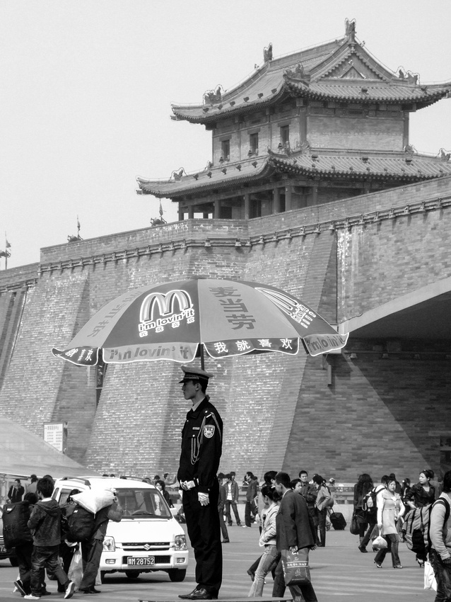 Chinese Traffic Policeman under a McDonald's Umbrella