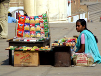 Indian girl sell sweets on a road