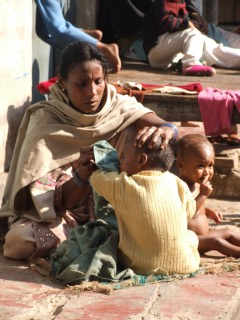 Mother Tending to her children, Saranath, India