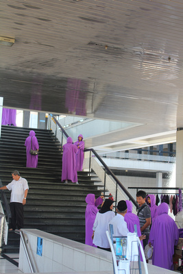 Tourists in purple robes at the national mosque of Malaysia