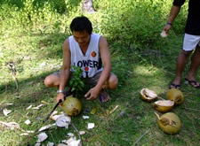 Cutting open coconuts in the Philippines
